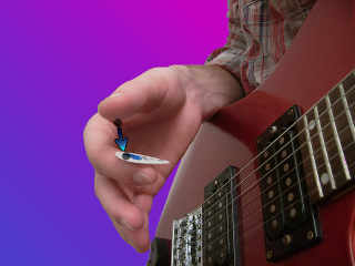 positioning the guitar pick - image 1