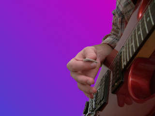 positioning the guitar pick - image 2