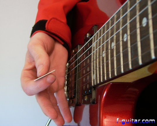 Performing a rake on electric guitar - picking hand