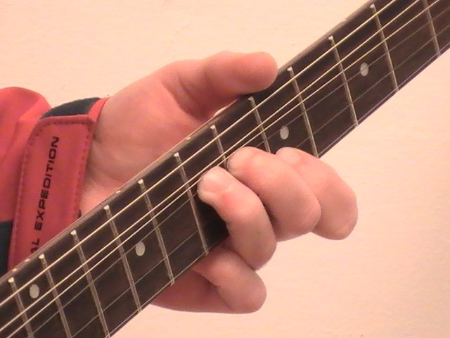 A Thumb positioning when performing a unison string bend